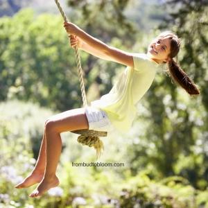 Girl swinging in tree.
