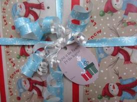 """Printable """"Jesus is the Reason for the Season"""" Christmas gift tag."""